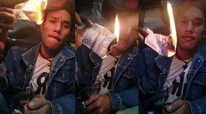 VIRAL, Pria Dalam Akun FB Sitanggang Parsamosir Bakar Uang Rupiah Terancam Penjara 5 Tahun Denda 1 M